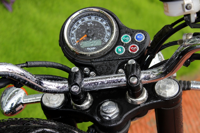 Plain Jane instrument cluster with a small digital screen below the speedometer showing the odometer reading and a couple of warning lights to the right hand side