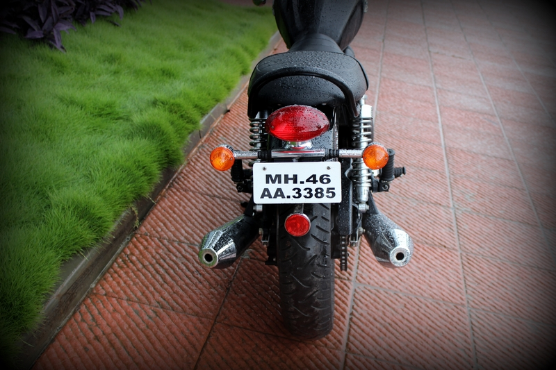 130 section rear tyre, and the twin exhaust pipes on either sides make the bike look wide