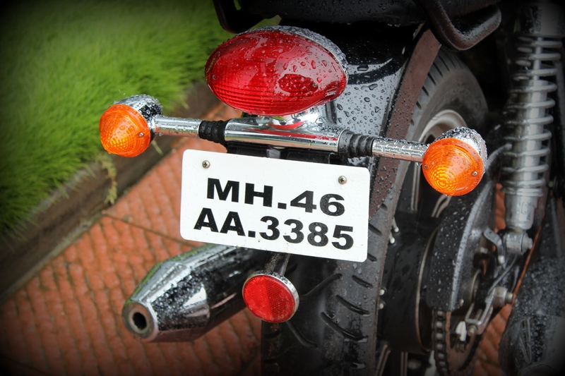 Tail lamp, turn indicators and a reflector below the number plate