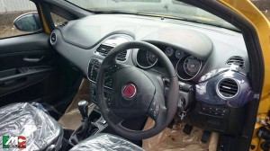 Fiat Punto facelift in all black interiors. Dashboard is similar to the Linea facelift.