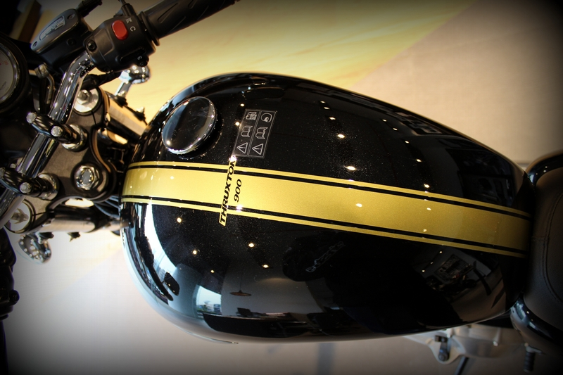 Gold stripe add to that racy look. Offset fuel filler cap, just like the Bonneville.
