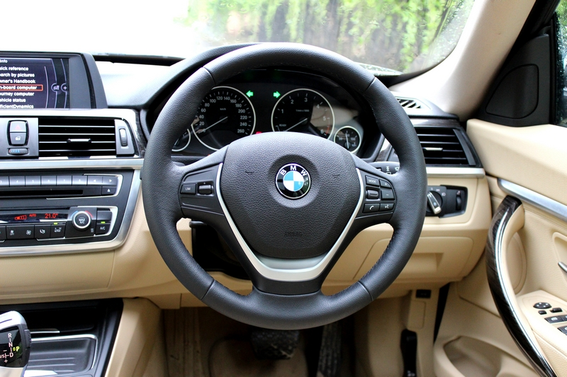 Steering wheel is perfect in size. Touch and feel is average, and does not get paddle shifts.