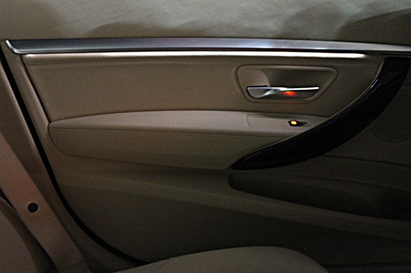 Ambient lighting below the silver accent on the doors