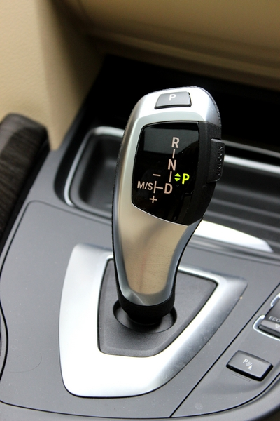 Gear lever fits in your hands perfectly. Press the unlock button on the side to shift gears.