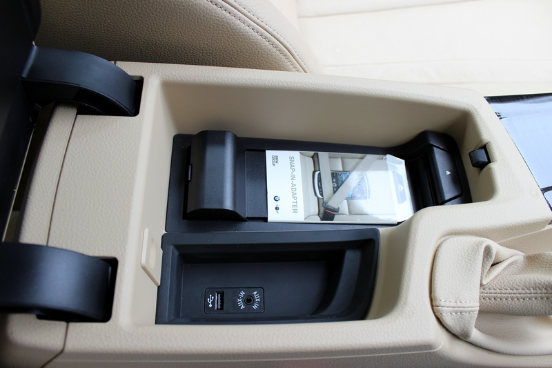 Storage cubicle below the sliding driver armrest. USB, Aux-in and iPhone adapter placed here.