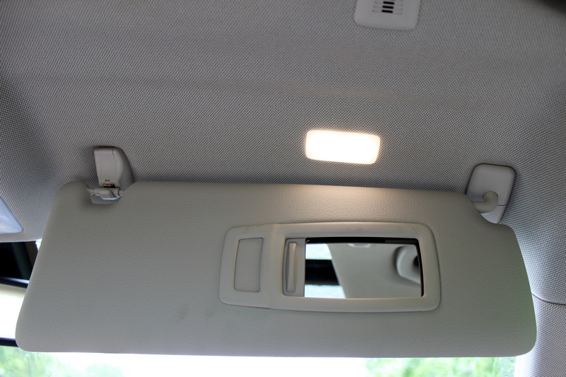 Sun visor with illuminated vanity mirror