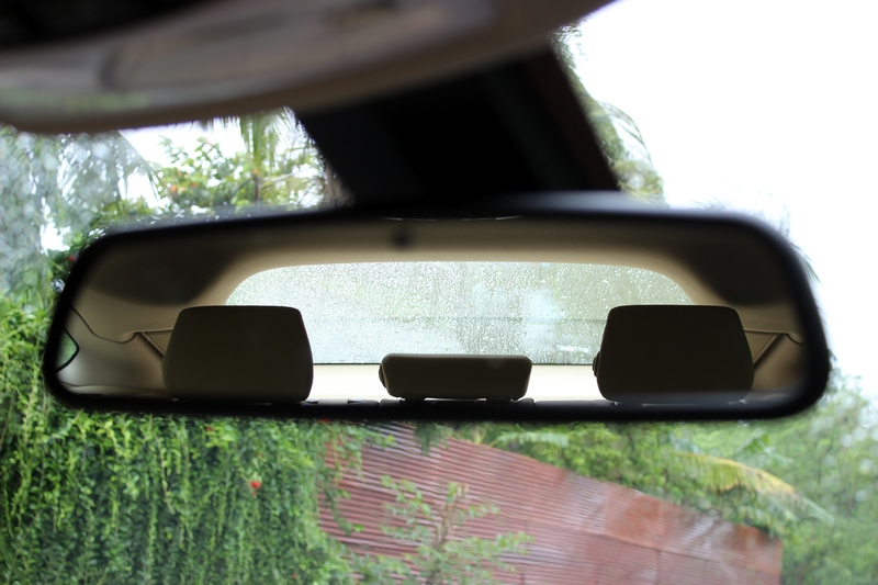 Inside rear view mirror covers all of the small rear windscreen area