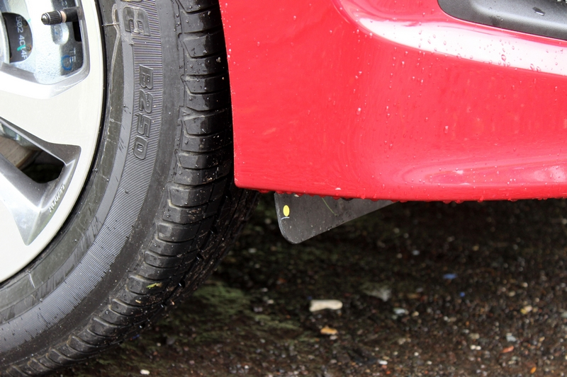A small mud flap ahead of the front tyres to handle the air flow