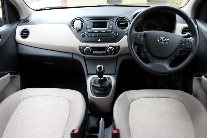 Dual tone beige and black dashboard similar to the Grand i10