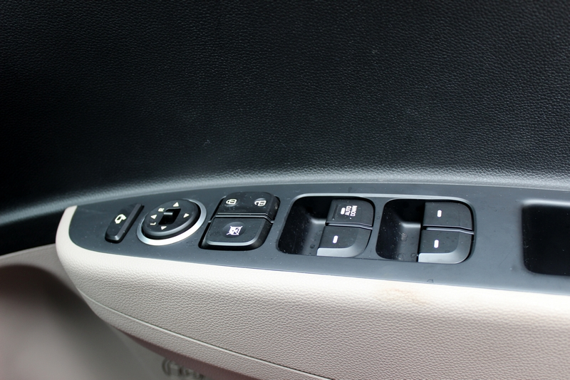 One touch down for the driver side window, the top most button is to electrically fold the ORVMs