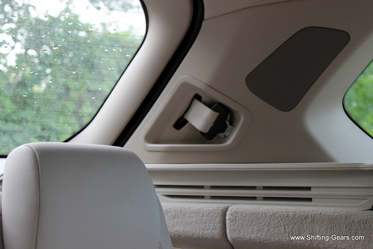 A speaker mounted on the D pillar and the third row seatbelt neatly tucked in
