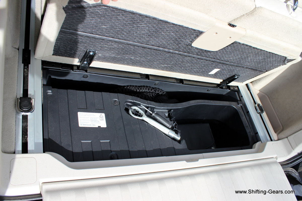 Tool kit placed under the boot floor