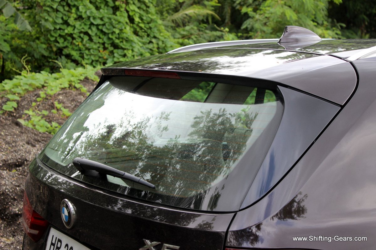 The SUV does not get a full size spoiler, but this top section on the boot lid poses like one