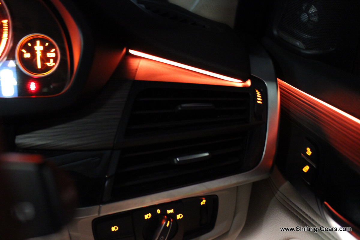 Ambient lighting reaches out on the dashboard, end to end. Also seen here are the dual AC vents