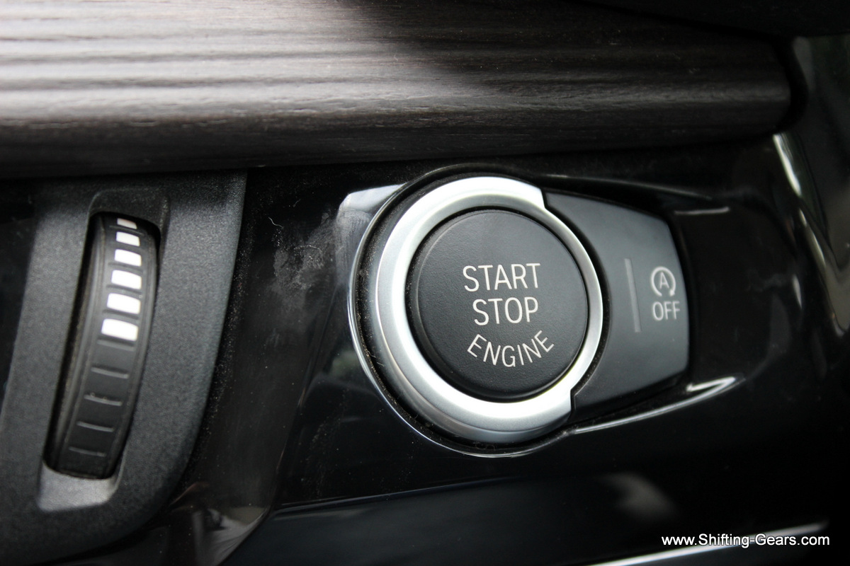 Start stop button and the Auto-Start stop control switch next to it
