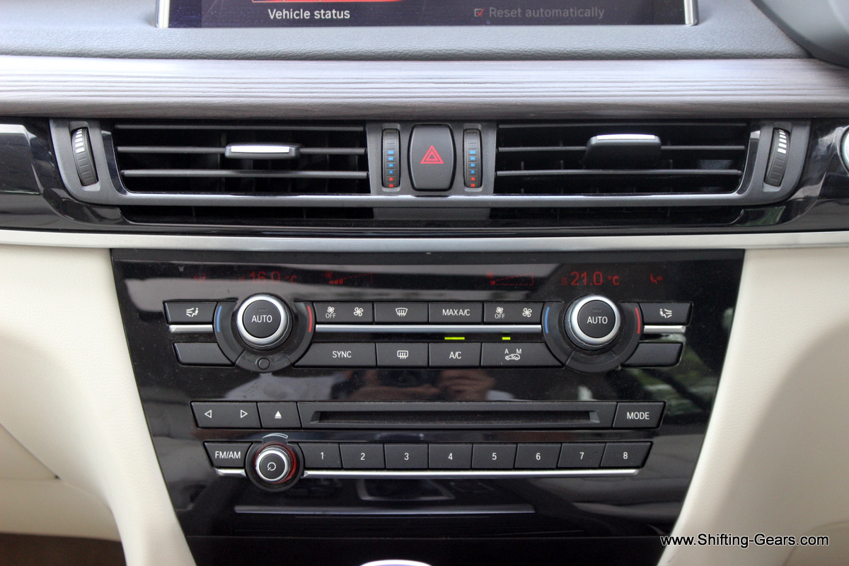 Dual zone automatic climate control and the stereo console powered by Harman Kardon surround system. A total of 16 speakers.
