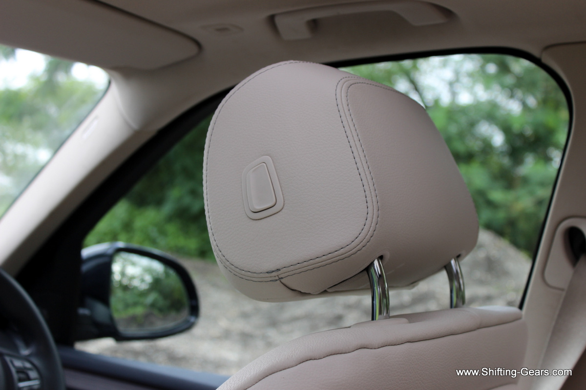 Neck restraints can be adjusted by pressing this button on the side
