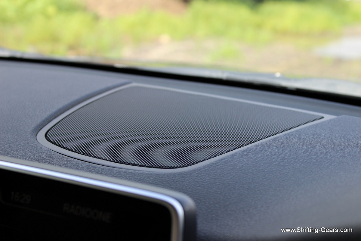 A speaker placed behind the infotainment screen