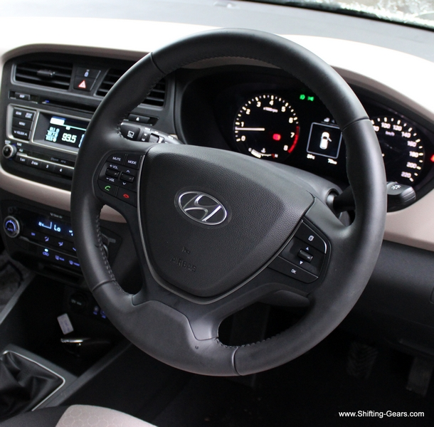Steering wheel is identical to the Grand i10 / Xcent except for the chrome surround on the horn pad. Also, steering controls are different here.