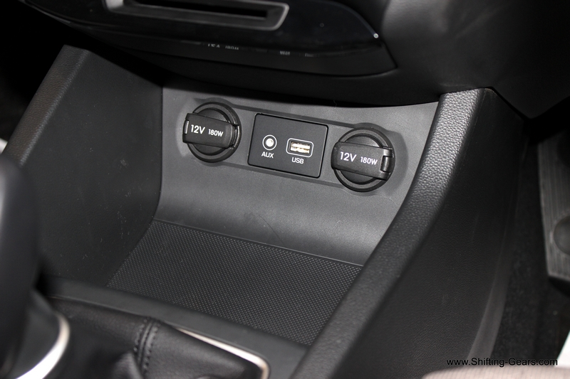 Two charging points below the AC controls and the Aux-in and USB slot in between them