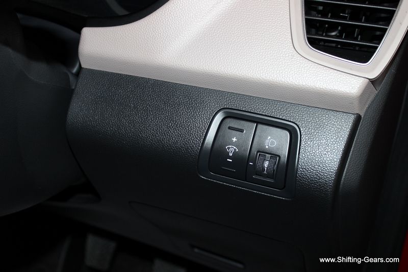 Instrument cluster illumination intensity and headlamp leveler control to the RHS of the steering