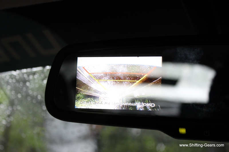 Rear view mirror is an electrochromic unit and houses the display for the reverse camera. A software glitch seen here, the parking display was inverted.