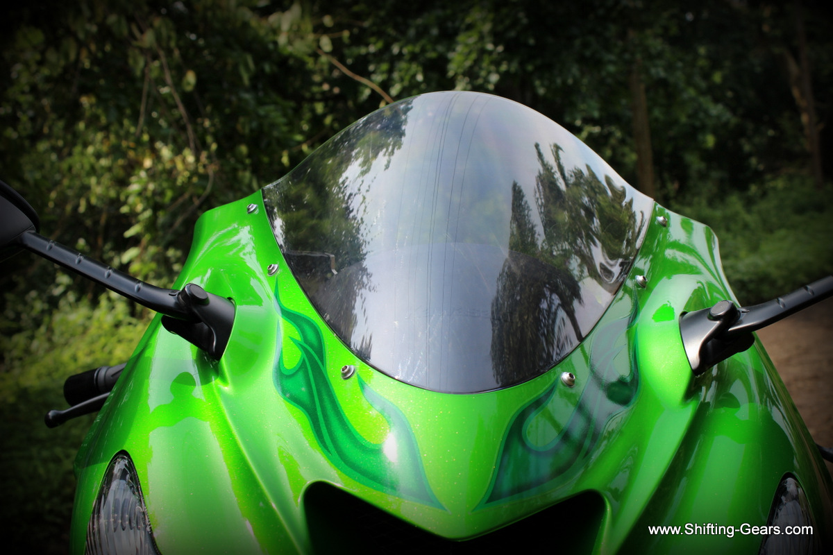 Windscreen is bubble shaped, and works perfect in deflecting wind when you lean forward