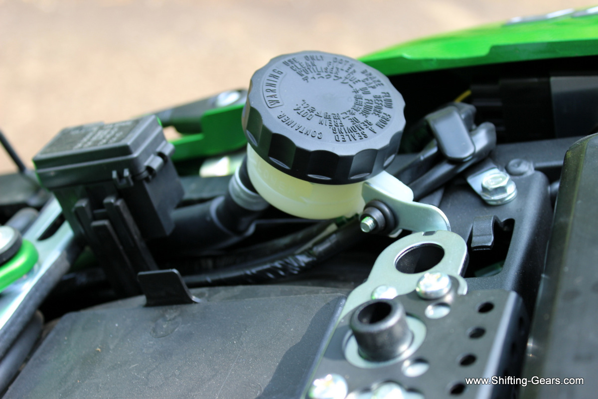 Rear disc brake oil filler is located under the seat