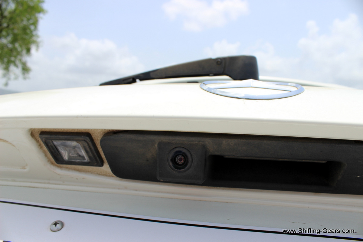 Rear view camera tucked under the Mercedes logo