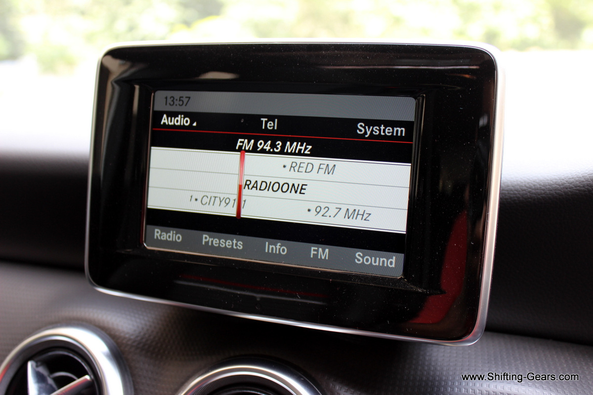 "A 5.8"" display screen sits above the AC vents on the dashboard. Glossy surround needs regular cleaning."