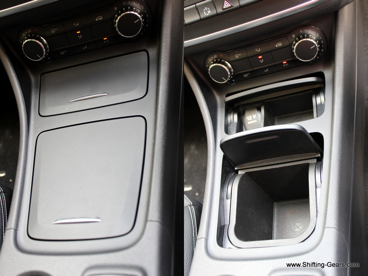 Centre console storage bins are neatly covered with a lid