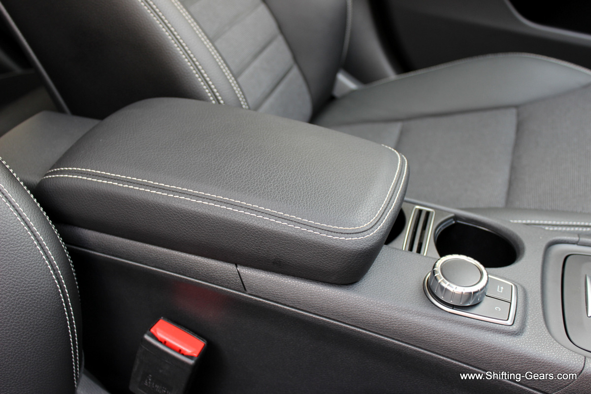 Close look at the front armrest. Has a fixed position and is far behind the ideal spot.
