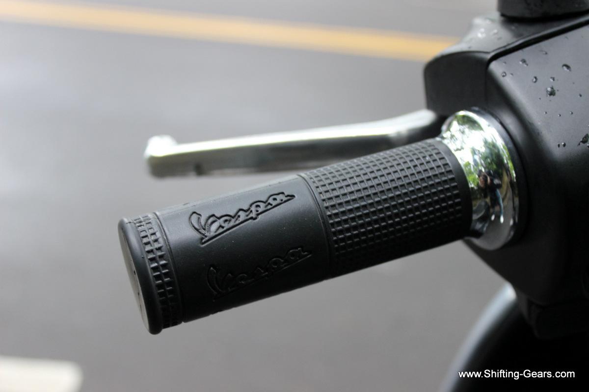 Vespa branding on the handlebar grips, chrome ring on the inside