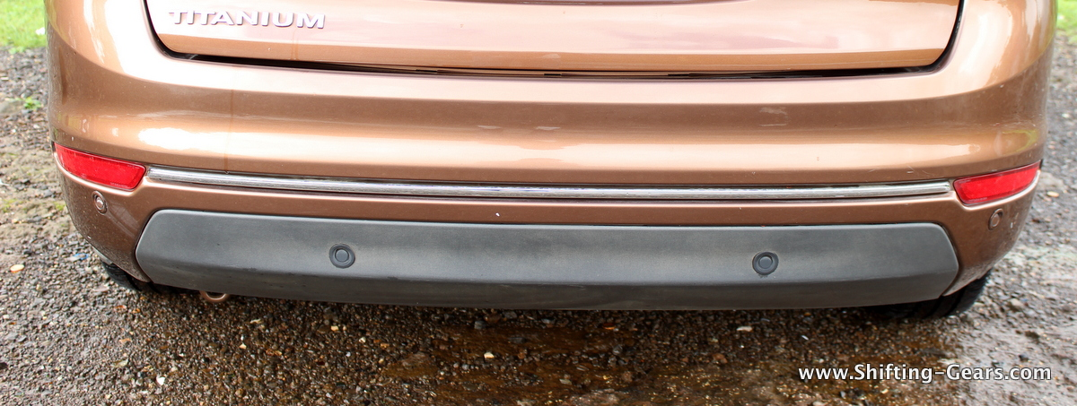 Blackened lower end on the rear bumper and a chrome strip above. Parking sensors are in both black and body colour - NEAT.