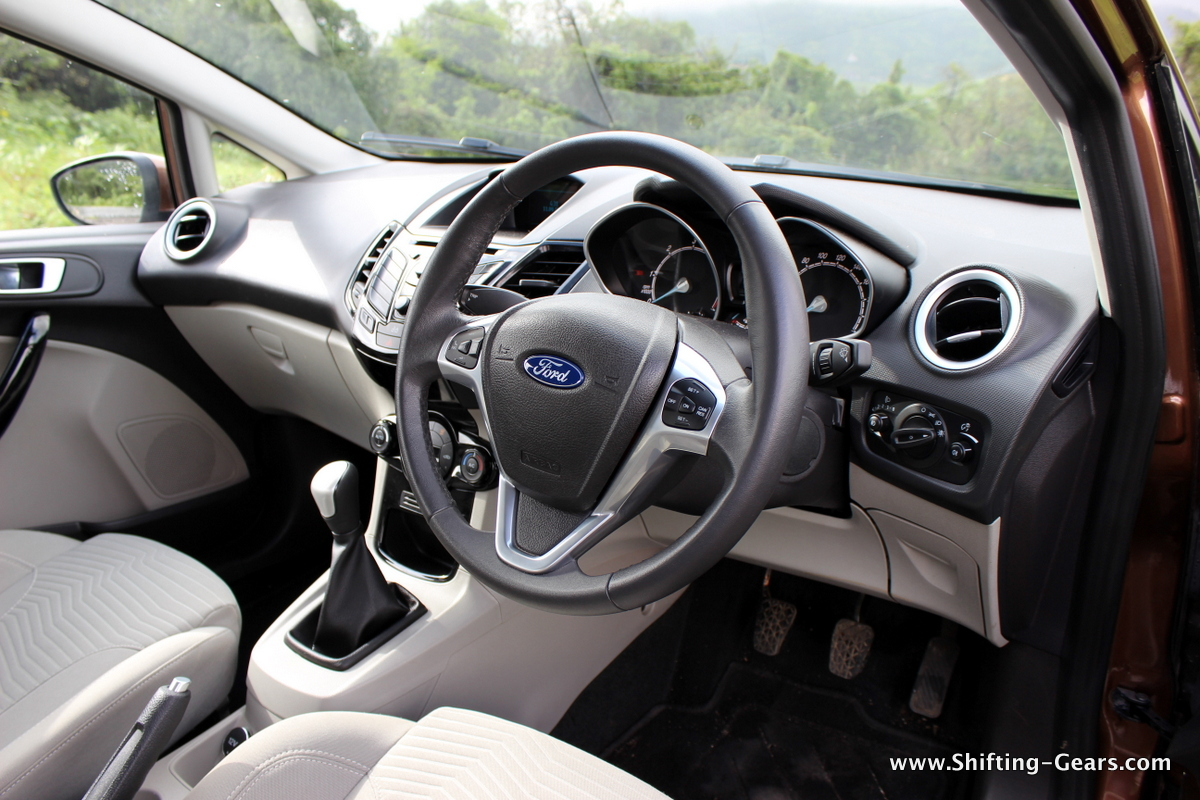 Interior colour scheme has been changed to beige and black as opposed to the previous all-black interiors