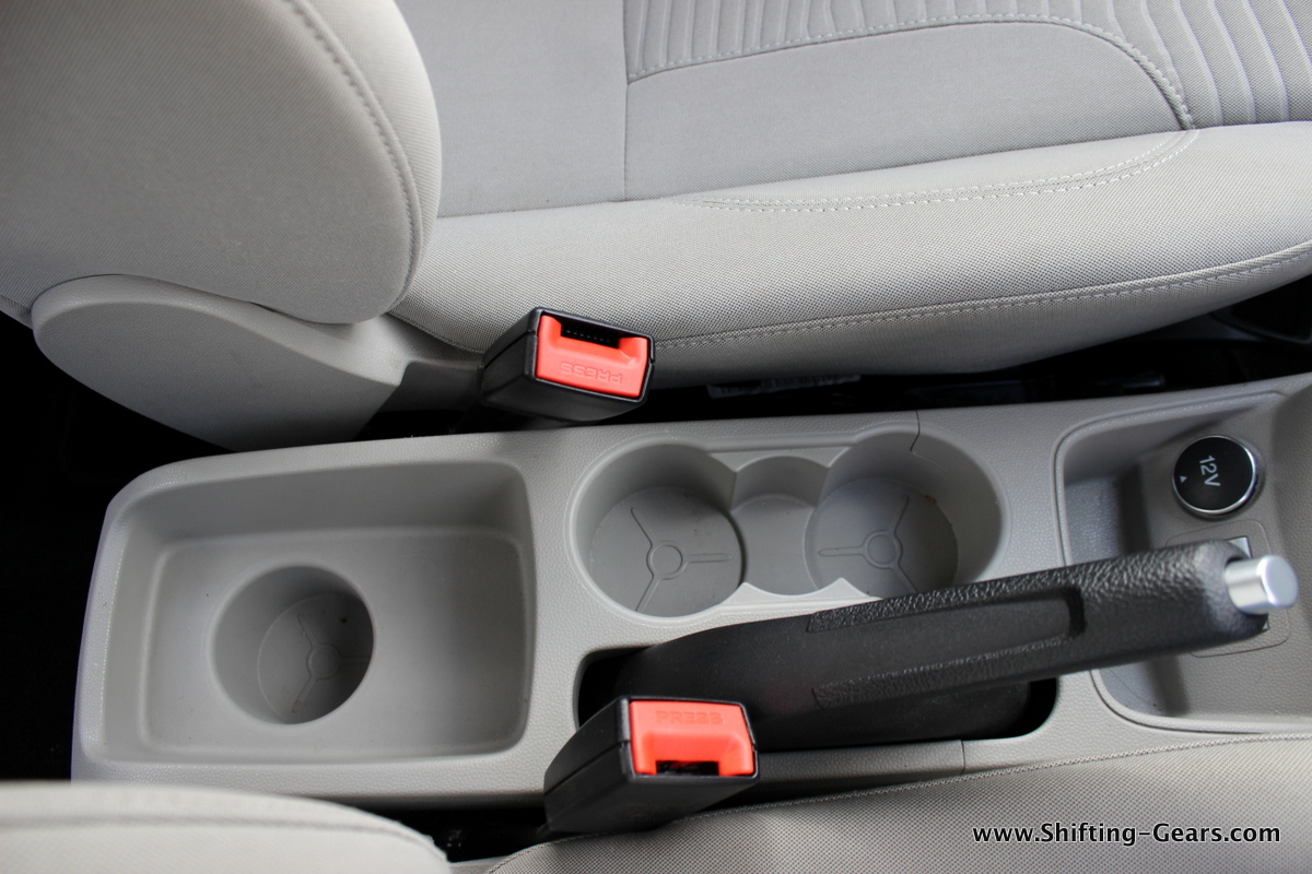 A total of three cup holders around the handbrake
