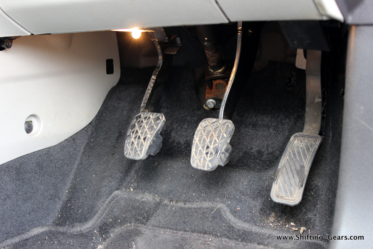 Useful dead pedal, and the super cheap bulb exposed which works as footwell lighting
