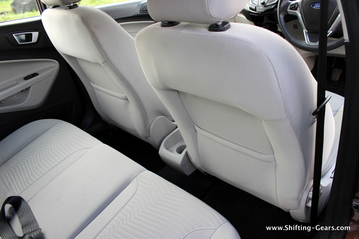 Legroom for the rear passengers is inadequate. Seat-back pockets on both the front seats.