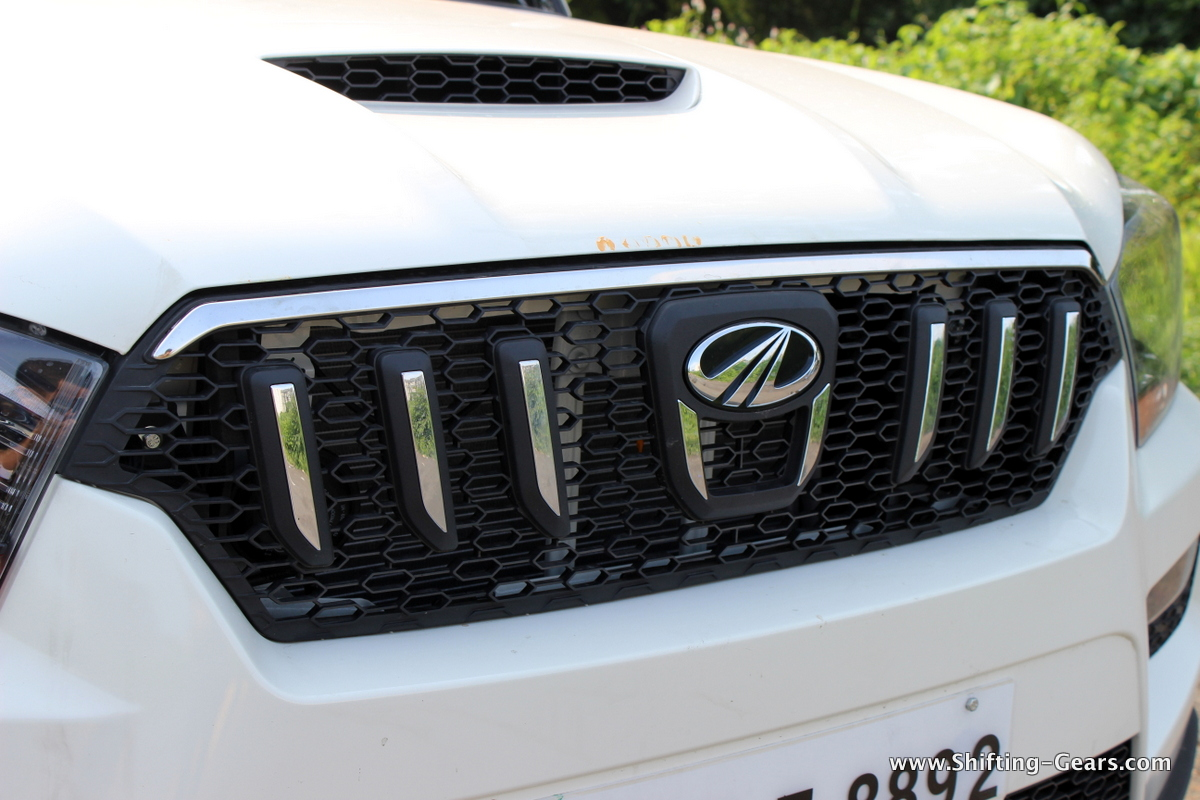 New front grille with chrome inserts. It is probably the new grille which takes away from the butch looks.