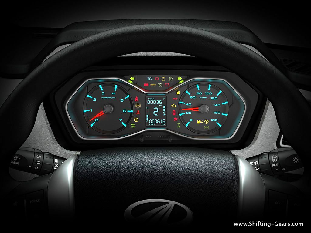 Blue backlit instrument cluster with a host of tell-tale lights and a MID in the centre
