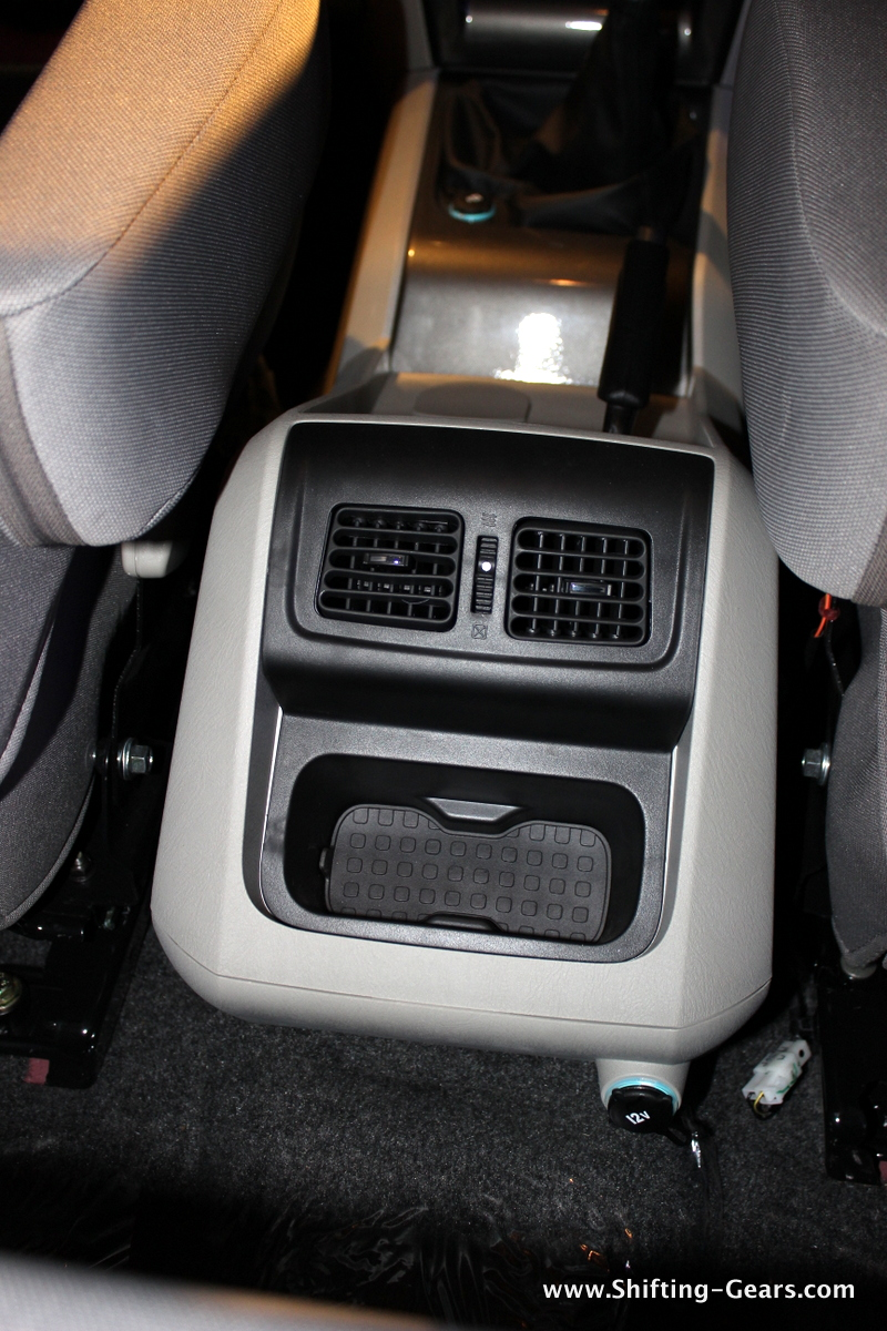 Rear AC vents and a storage bin below