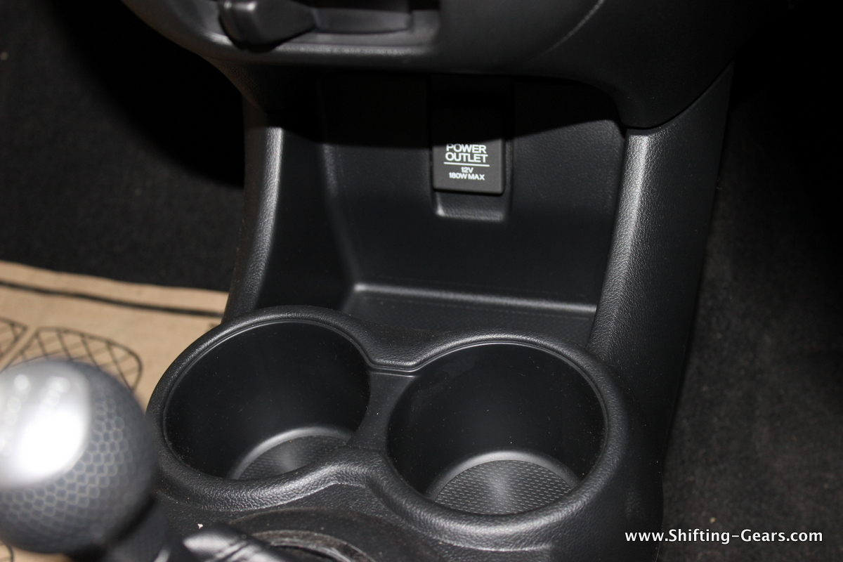 2 cup holders ahead of the gear stalk and a storage bin