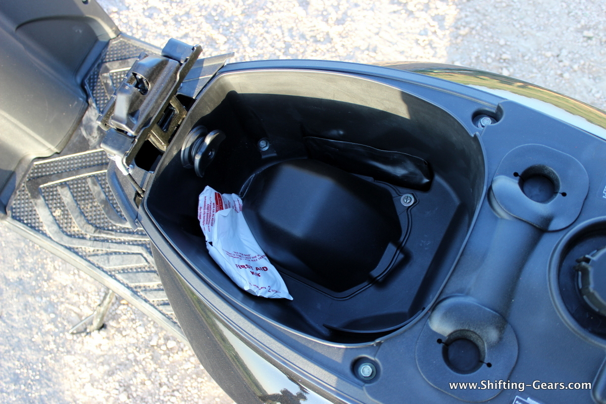 Storage space is good for a half helmet or small size full-face helmet