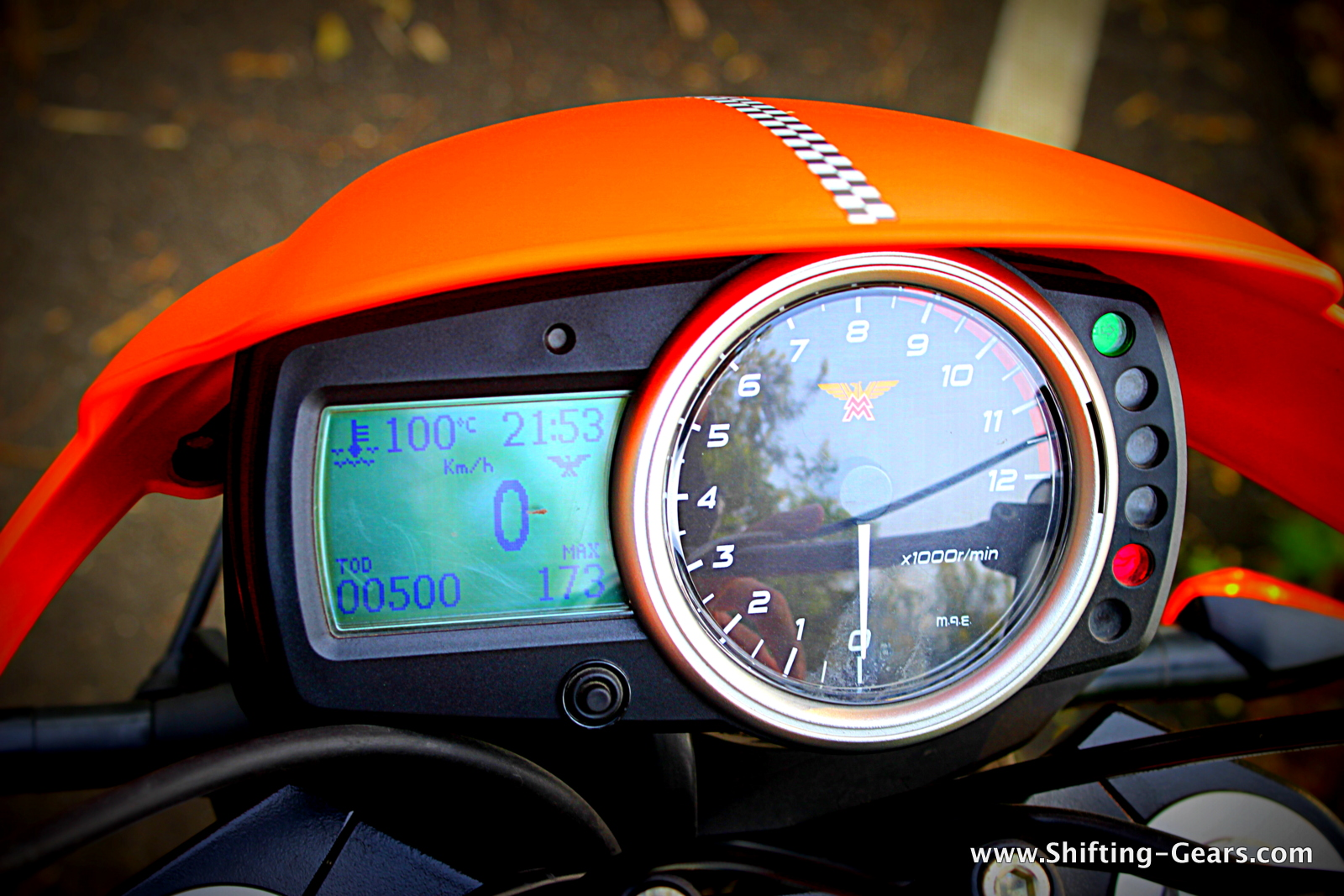 Analogue + digital instrument cluster lacks premium appeal, surely not the right quality for a bike costing upwards of Rs. 30 lakh
