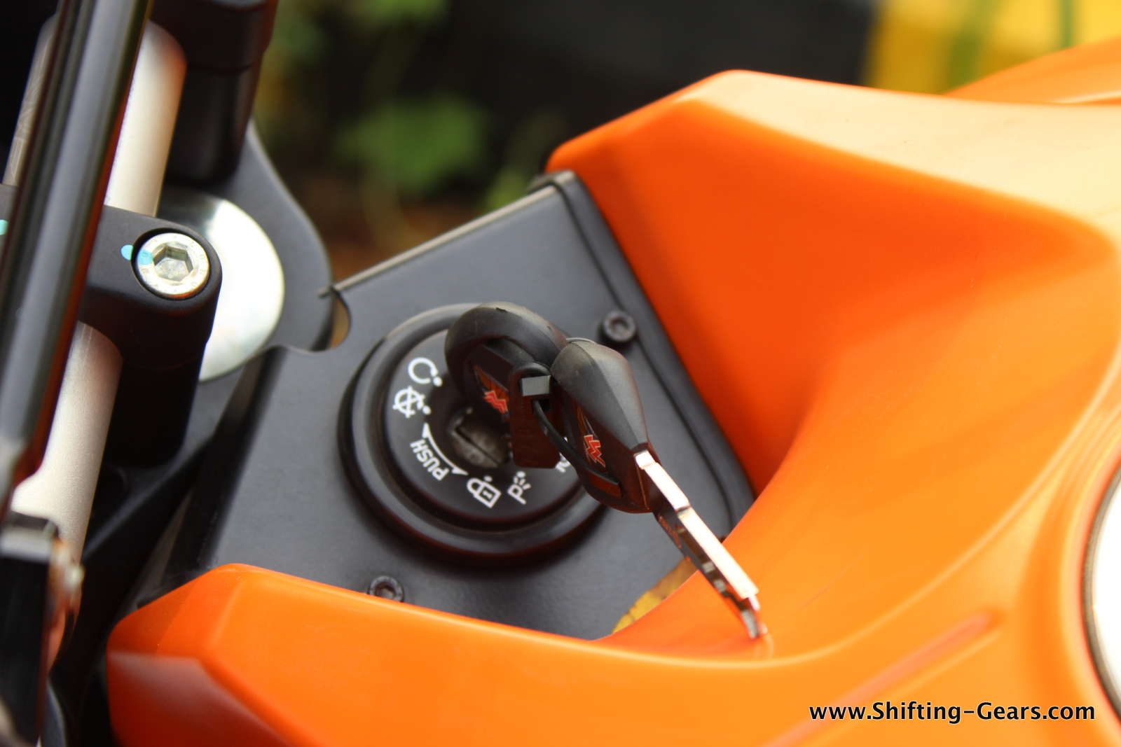 Keyhole is placed below the handlebar, ahead of the fuel tank