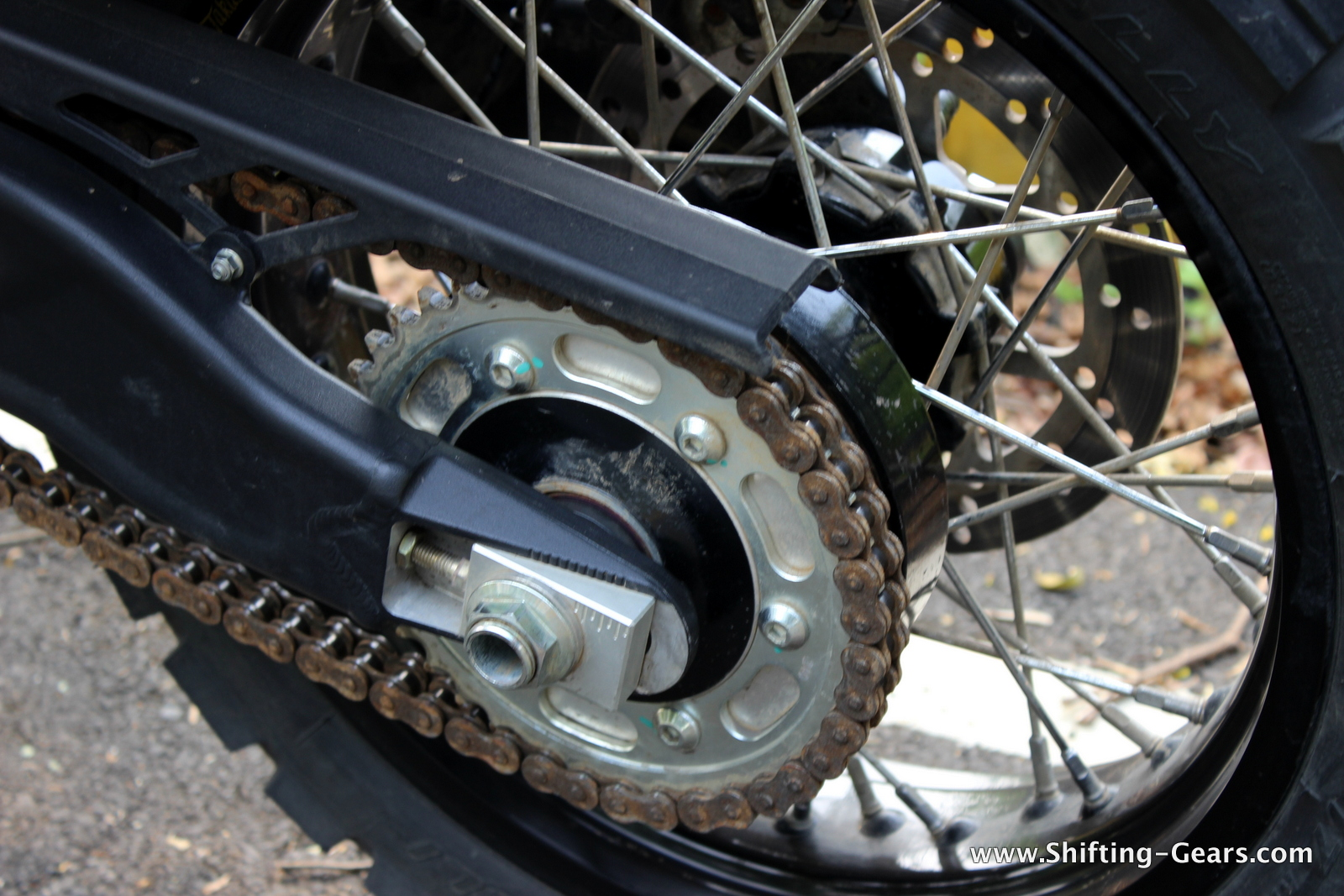 Close look at the chain cover, chain sprocket and chain adjustment lever