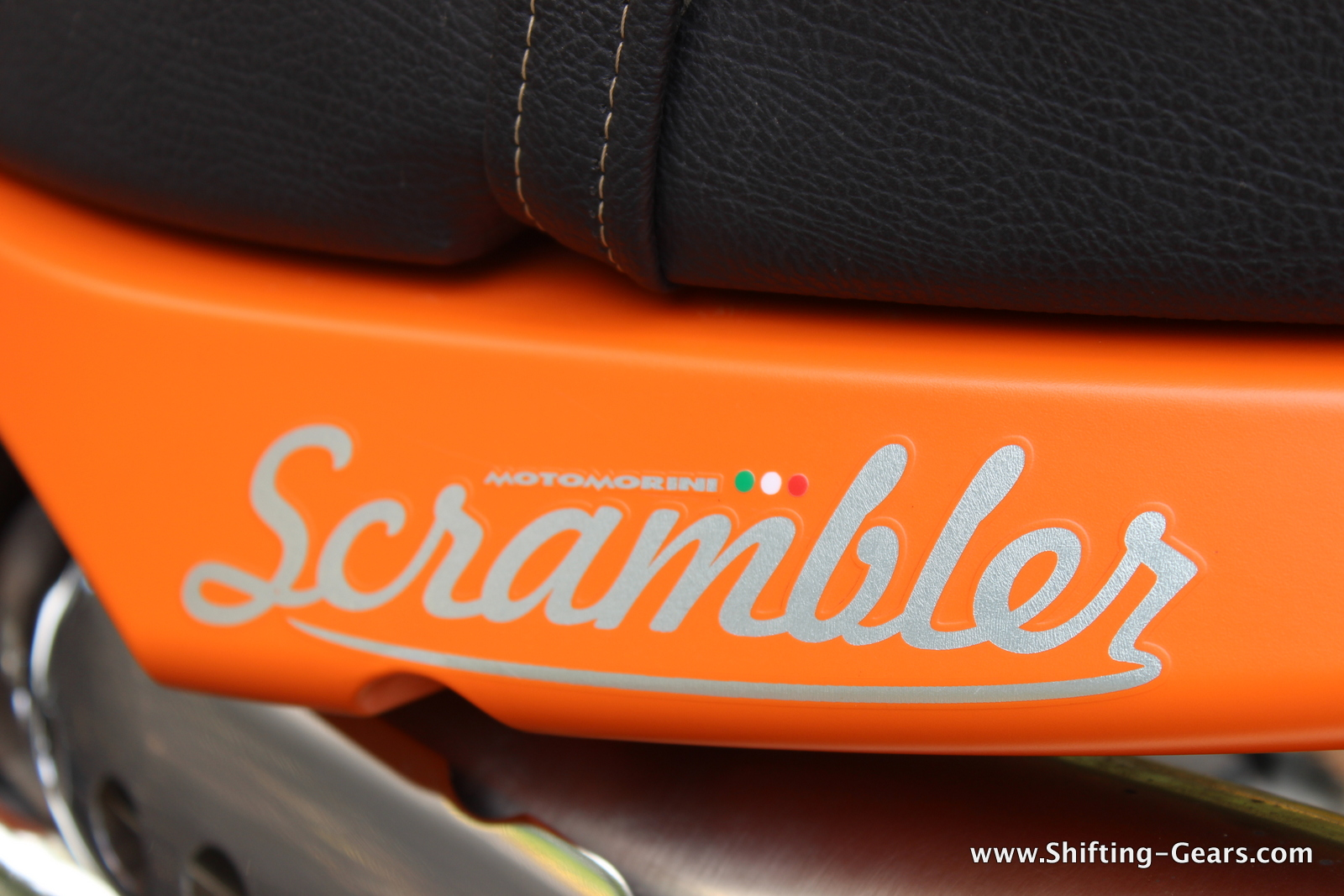 The Scrambler decal with a small Italian flag under the pillion seat