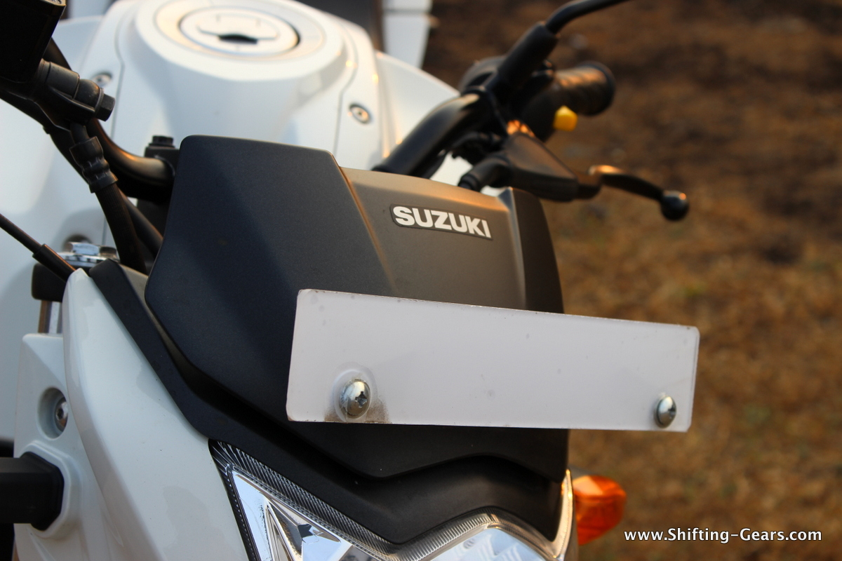Small, black plastic-finished wind deflector covers the instrument cluster