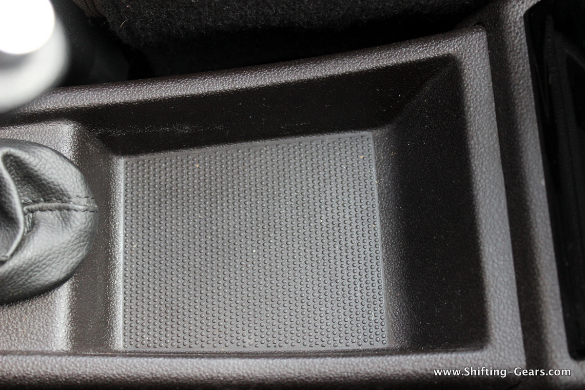 A storage spot under the handbrake is useful to park your wallet